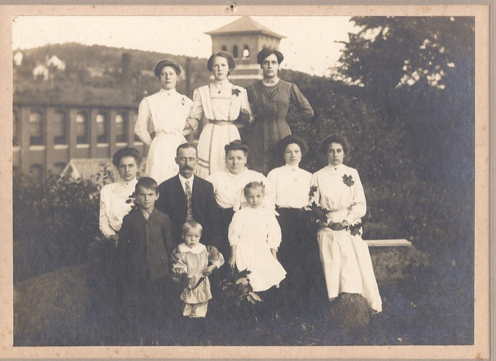 This image shows a family outside of a mill. Names are unknown.