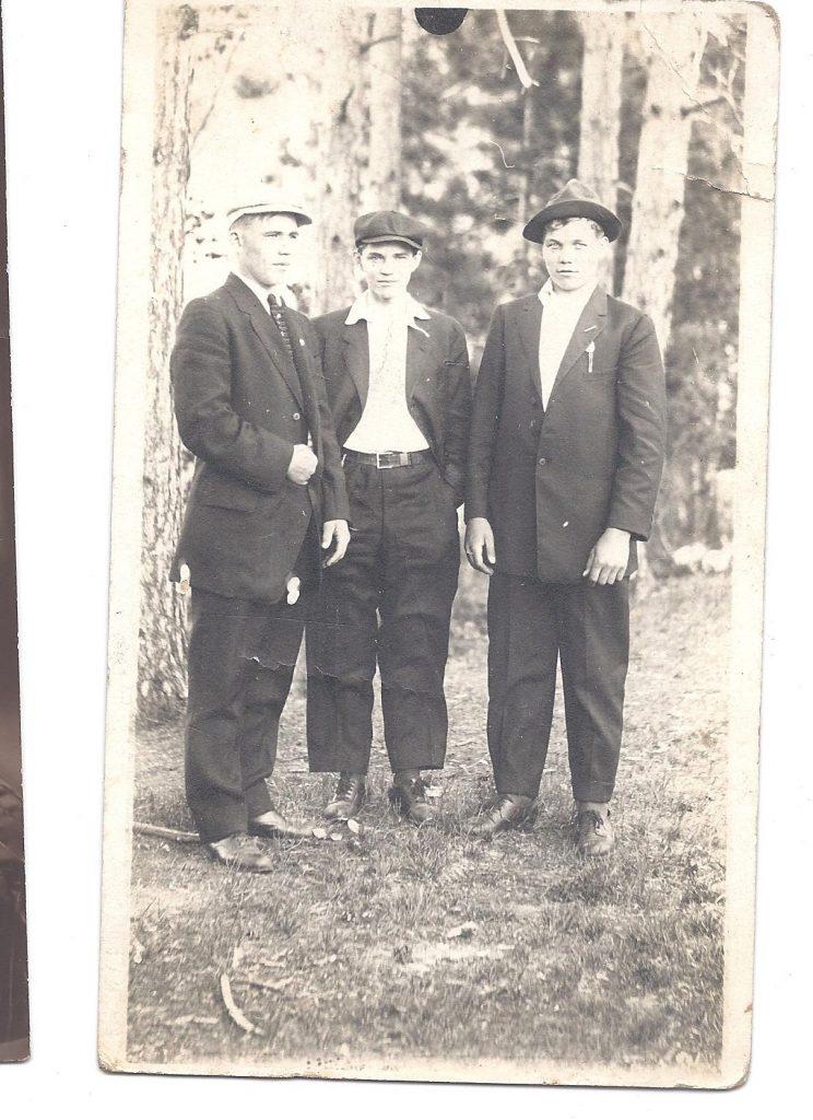 Three men in the woods.